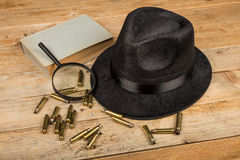 Mystery genre. Conceptual still life standing for film noir and crime and mystery novel genre Royalty Free Stock Image