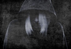 Mystery girl hiding her face under the hood Royalty Free Stock Images