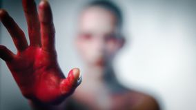 Mystery girl stretch her bloody arms forward to camera. Focus on hand stock footage
