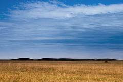 Mystery Hills in the Kansas Tallgrass Prairie Preserve. Dark Mysterious Hills in the Kansas Tallgrass Prairie Preserve create a moody pastoral scenic of the Stock Image