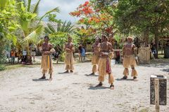 Mystery Island Dance Group. MYSTERY ISLAND, VANUATU, PACIFIC ISLANDS: DECEMBER 2,2016: Performance dance group, spectators, and lush, tropical flora on Mystery Royalty Free Stock Image
