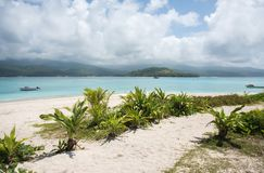 Mystery Island: Mountain and Sea View. MYSTERY ISLAND, VANUATU, PACIFIC ISLANDS: DECEMBER 2,2016: Nautical vessels in the Pacific Ocean with volcanic island Stock Photography