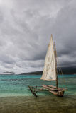 Mystery Island. Old meets new: cruise ship and traditional outrigger Canoe on Mystery Island (Inyeug), Vanuatu Royalty Free Stock Photos