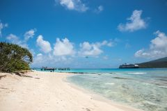 Mystery Island: Travel and Transport. MYSTERY ISLAND, VANUATU, PACIFIC ISLANDS-DECEMBER 2,2016: Mountain, Pacific Ocean waters, cruise ship and air taxi with Stock Photography