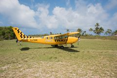 Air Taxi on Mystery Island. MYSTERY ISLAND, VANUATU, PACIFIC ISLANDS: DECEMBER 2,2016: Air taxi and tropical flora with tourists on the remote, Mystery Island Royalty Free Stock Photos
