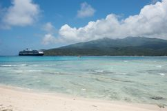 Cruising to Mystery Island, Vanuatu. MYSTERY ISLAND, VANUATU, PACIFIC ISLANDS-DECEMBER 2,2016: Holland America Cruise liner and mountain landscape with the Royalty Free Stock Photo