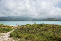 Touring Mystery Island`s Paradise. MYSTERY ISLAND, VANUATU, PACIFIC ISLANDS: DECEMBER 2,2016: Pacific Ocean with volcanic mountain landscape and remote beach Stock Photo