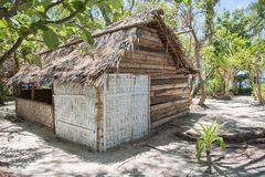 Hodge Podge Hut on Mystery Island. MYSTERY ISLAND, VANUATU, PACIFIC ISLANDS-DECEMBER 2,2016: Rustic thatched roof architecture with a variety of materials and Stock Image