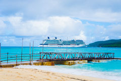 Mystery Island, Vanuatu pier. Surrounded by coral reefs Mystery Island measures less than 1 square kilometre in area, is uninhabited and a favourite stopover for royalty free stock image