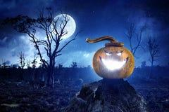 Mystery of Jack pumpkin. Halloween glowing Jack pumpkin against night sky. Mixed media Stock Image