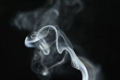 Mystery light blue smoke over dark background with copy space Stock Photo