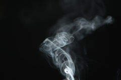 Mystery light blue smoke over dark background with copy space Royalty Free Stock Images