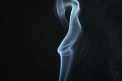 Mystery light blue smoke over dark background with copy space Stock Images