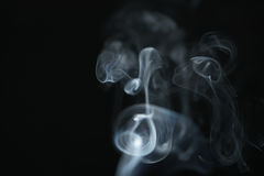 Mystery light blue smoke over dark background with copy space Stock Photography
