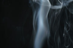 Mystery light blue smoke over dark background with copy space. Abstract photo Stock Image