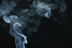 Mystery light blue smoke over dark background with copy space. Abstract photo Royalty Free Stock Image