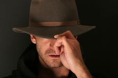 Mystery man with hat. Mystery dark man with hat stock photos