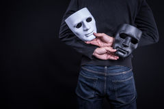 Mystery man holding black and white mask Royalty Free Stock Photography