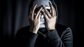 Mystery man wearing white mask stock photo