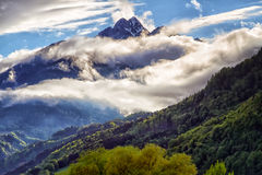 Mystery mountain landscape with dark clouds sunligh Stock Photo