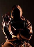 Mystery preaching monk with bible Royalty Free Stock Photo