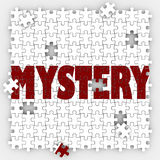 Mystery Puzzle Pieces Hole Unknown Uncertainty Guessing Solved S. Mystery word on puzzle pieces to illustrate solving an unknown problem or uncertainty with a Stock Photo