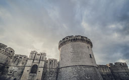 Mystery ruins of medieval old tower of castle under dark scary cloudy sky in Matera Italy. Fortress in Matera Stock Photography