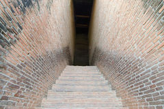 Mystery walkway passage with brick wall on both sides Stock Photo