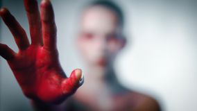 Mystery weird girl with bloody hand. Horror and mystic concept stock video