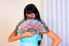 Mystery woman. With a fan Royalty Free Stock Images