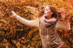 Mystery woman against autumnal leaves outdoor Royalty Free Stock Image