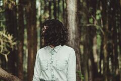 Mystery woman emerging from forest Stock Image