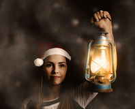 Mystery woman on a find and seek christmas journey Royalty Free Stock Photo