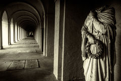 Mystic Ancient Stone Corridor and Rome Marble Statue Stock Photos