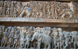 The mystic animal and war scenes carved in Hoysaleshwara temple at Halebidu Royalty Free Stock Photography