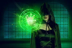 Mystic asian woman in witch costume showing pentagram design fro. M his hand on the dark room stock images