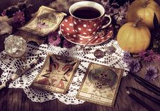 Fortune telling ritual with the tarot cards, pumpkins and cup of tea royalty free stock photos