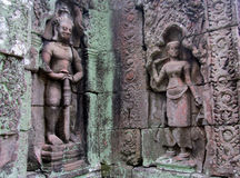 Mystic bas-relief on the walls of Cambodian ancient city Ankgor Wat. Mystic bas-relief on the walls of asian ancient temple city Ankgor Wat in Cambodia. Statuers Royalty Free Stock Images