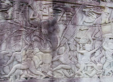 Mystic bas-relief on the walls of Cambodian ancient city Ankgor Wat Royalty Free Stock Photography
