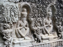 Mystic bas-relief on the walls of Cambodian ancient city Ankgor Wat. Mystic bas-relief on the walls of asian ancient temple city Ankgor Wat in Cambodia. Statuers Stock Images