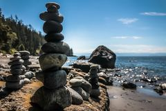 Rock Creations Found on the Beach. MYSTIC BEACH, VANCOUVER ISLAND, BC - JULY 19, 2017 - Built rock towers in front of The Pacific Ocean on July 19th, 2017, on Stock Images