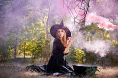 The forest enigmatic witch in the green wood outdoors. Stock Photos