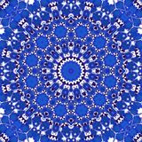 Mystic blue cornflower in circle floral kaleidoscope style. Blue cornflower in circle floral kaleidoscope style royalty free stock image