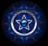 Mystic blue star. Mystical, blue, patterned silver star on a black background Stock Photography