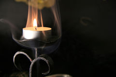 Mystic candles. Magic atmosphere with candle in smoke Stock Photos
