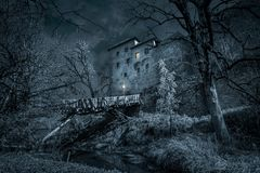 Mystic castle in the night with moat Royalty Free Stock Photo