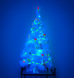 Mystic Christmas tree. Unusual Christmas tree in a blacklight Royalty Free Stock Images