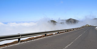 Mystic cloud fields conquering the mountain road Royalty Free Stock Images