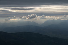 Mystic clouds. Evening clouds in the mountains royalty free stock photo