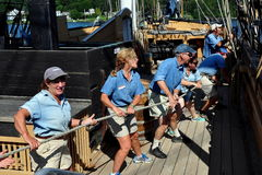 Mystic, CT: Crew Pulling Rope on Whaling Ship Royalty Free Stock Images